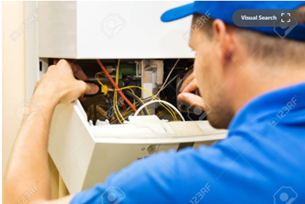 gas engineer servicing a domestic boiler