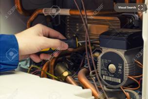 gas engineer repairing a boiler pump